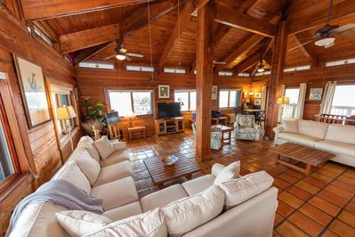 Open living area with high ceilings and beams