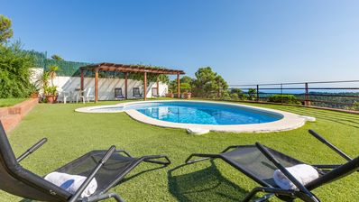 Photo for 3 bedroom Villa, sleeps 8 with Pool, Air Con, WiFi and Walk to Shops