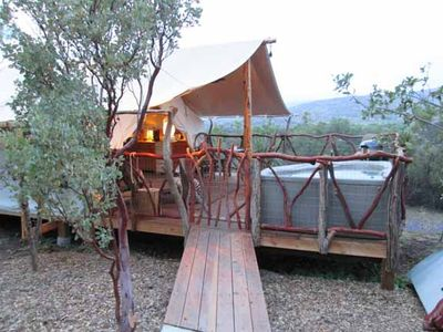 luxury safari tent in fenced compound on private ranch in San Diego county