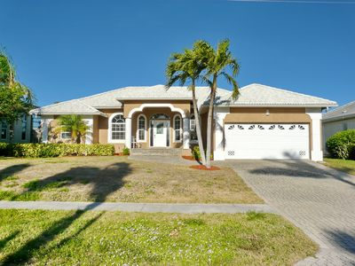 Photo for Inviting waterfront home w/ heated pool & direct access to Gulf of Mexico