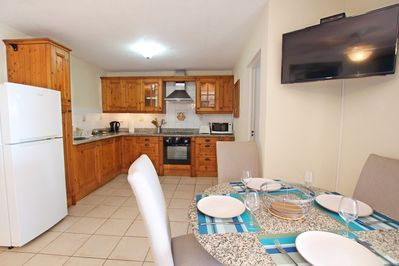 Dining area with seating for four and fully outfitted kitchen