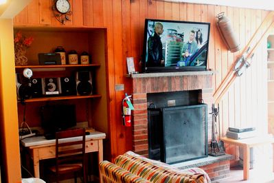 Wood burning fireplace with free firewood, hi-def flat screen Sony TV