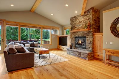 Enjoy the beautiful stacked stone fireplace in the enormous sunlit living room.