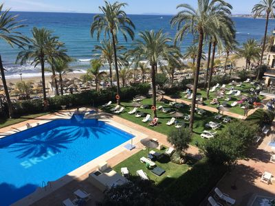 Photo for Skol beachfront central 1 bedroom with pool, garden, views and wifi