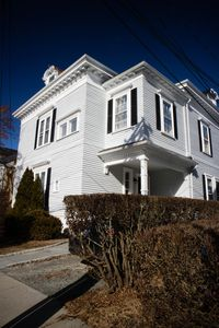 The granite walk leads welcomes you to this beautiful Victorian home
