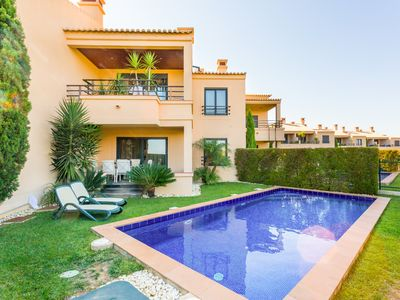 Photo for Two bedroom ground floor apartment with private garden with pool and sea view