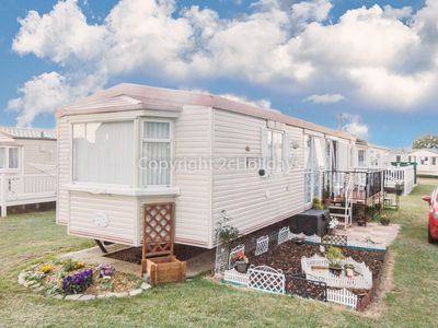 Photo for Dog friendly caravan at Heacham in Norfolk sleeping 6 on a quiet holiday site.
