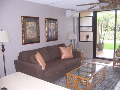Open, airy, naturally lit living area, access to lanai,. pool, and beach.