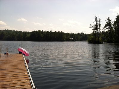 View of lake and small island from the sitting platform on the water