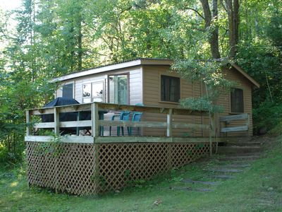 Photo for Studio Cabin Hidden in Towering Pines within 10 feet of lake. Pets accepted!