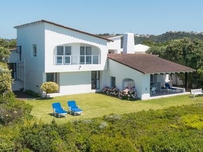 Photo for Wonderful holiday home right on Robberg Beach, Plettenberg Bay. Sleeps 8 people