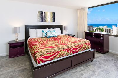 Bedroom with king size bed and ocean views