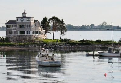 View of House from Cribstone Bridge;House is surrounded by water and boats
