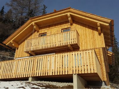 Photo for Ski in, ski out! Chalet from 2016 next to the slopes with inn-house sauna.