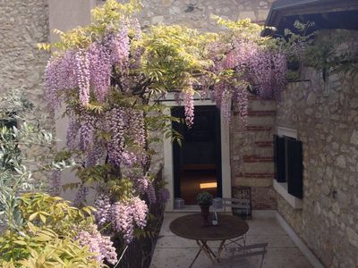 Photo for It is located in a villa of 1800, with a terrace overlooking the garden of the manor