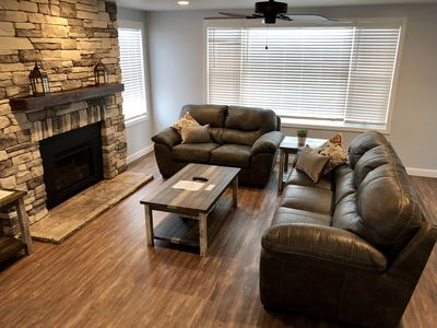 """Living room with 55"""" TV and Gas fireplace. Has pull out couch."""