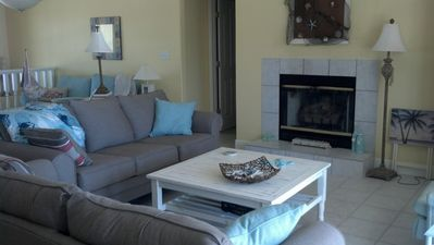 Living room with gas fireplace and sleeper sofa.