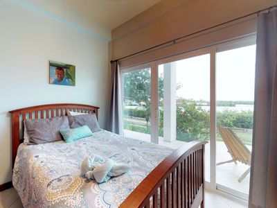 Photo for Lagoon-front condo with water views, shared pool, restaurant. Near town & beach!