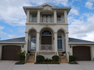 Elegant and classic exterior with plenty of parking and a balcony.