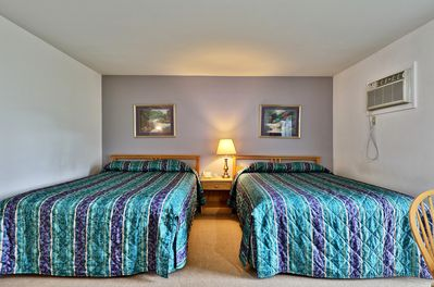 Room with 2 queen beds, TV  and A/C.
