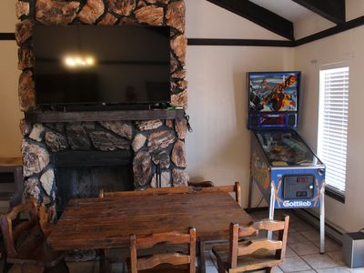 "Photo for Groovy 70's super fun! Close to Midtown with Atari, 65"" TV and pinball machine!"