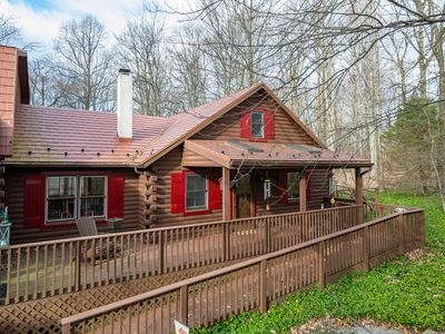 Photo for Quaint wooded log cottage attached to the main house with many amenities.
