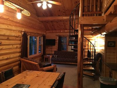 Log Cabin living area. It is an open concept! The TV is in the corner.