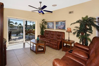 Florida room with 65 inch TV with large stack back sliding doors