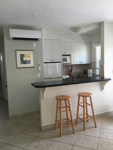 Full kitchen - All new cabinets, granite countertop, seated bar height counter