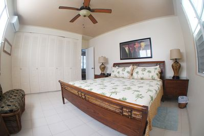 Pool level bedroom with king bed