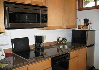 Kitchen - refrigerator, dishwasher, cooktop, convection/microwave, dishes, etc.