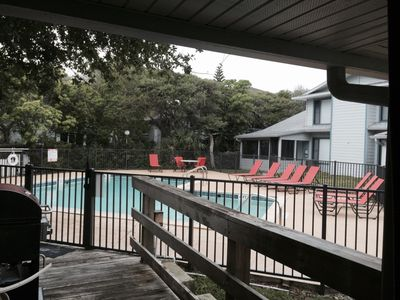 Photo for Relax by the community pool and walk to the beach