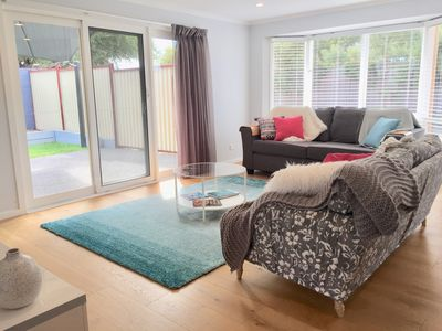 Light bright Lounge with queen bed and door to outside entertaining area.