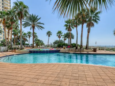 Photo for Gorgeous and cozy beachfront condo with shared pool and beach access!