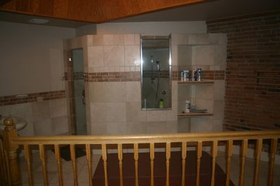 Master bathroom with steam shower and hot tub