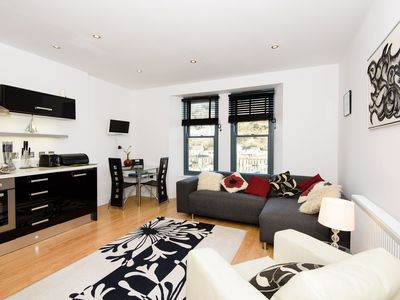 Photo for Modern town centre apartment with harbour views
