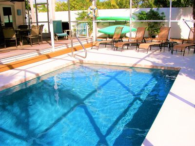 Lounge by your private heated pool