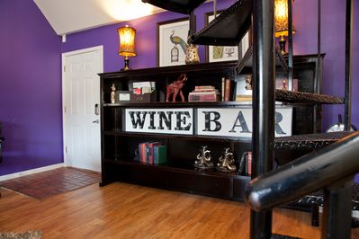 The Wine Bar sign near the entry.