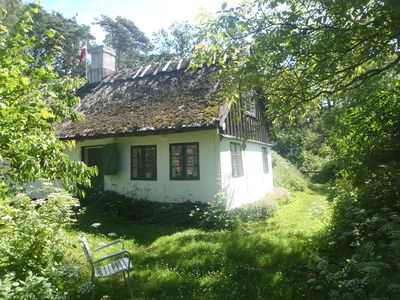 Photo for Idyllic old farmhouse in a protected scenic area near the forest and beach.
