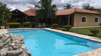 Photo for Beautiful country house, Condominium Porta do Sol, with pool, sauna and view to the mountains.