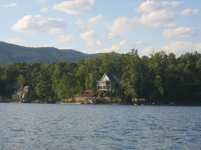 View of house from lake with Blue Ridge Mountains background- SumterNatlForest