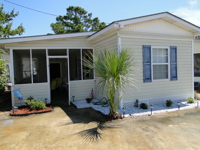 Photo for Cozy Beach House 1 Block From Beach. Wifi and Golf cart included