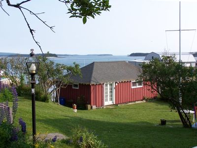 Photo for Cozy in-town cottage at harbor's edge w/ dock, 2 kayaks, walk to downtown.