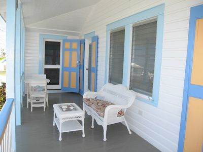 Front porch overlooking the beach & ocean. Shade with nice ocean breezes.