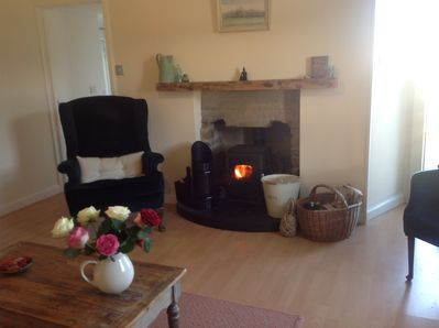 Cosy sitting room with multi fuel stove, air to air heating also.