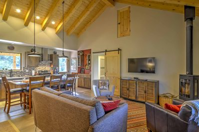 Stay warm by cuddling close to the wood-burning stove in the living area.