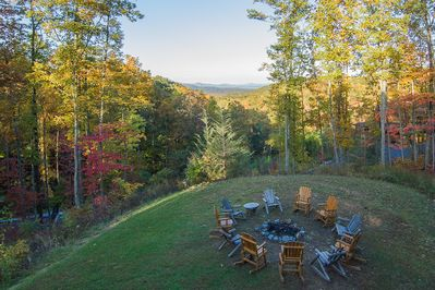 Cherokee Lodge sits on 3 acres! Enjoy the scenic back yard w/fire pit & hot tub