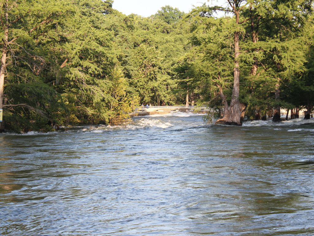 New Braunfels Cabin Rental   From The River Bank Looking At The Gruene  Bridge