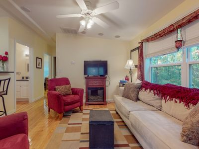 Photo for NEW LISTING! Cottage w/sun room, fireplace & shared pool/hot tub/gym -near beach