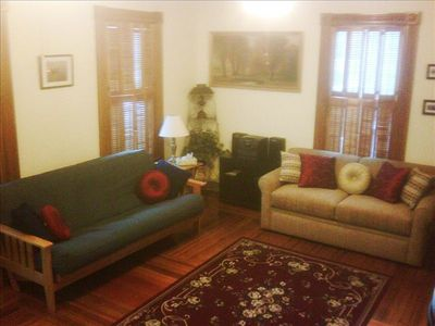 Full size sleeper sofa and futon in living room.